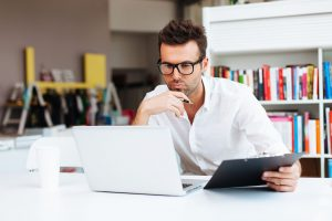 Man staring intently at computer