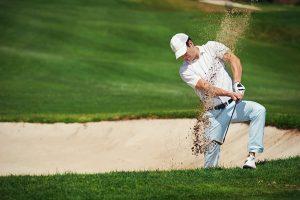 Golfer in sand