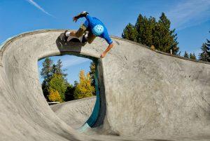 Skateboarder on steep curve