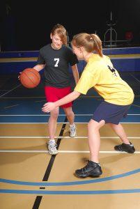 High school girls playing basketball