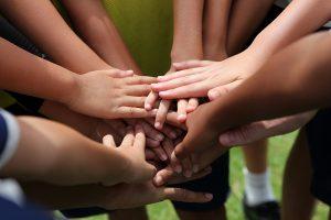 Youth hand huddle