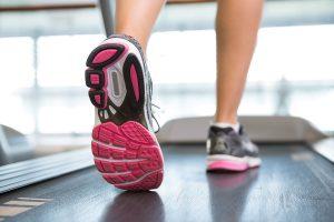 Woman walking on treadmill