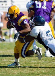 Football making tackle running back