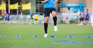 Soccer player doing ACL prevention program exercises