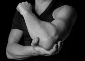Athlete with elbow pain after a triceps tendon rupture