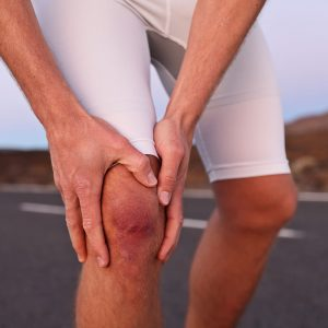Man with knee pain from a serious knee injury