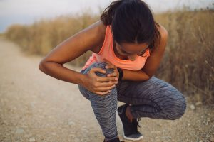 Female runner with knee pain from an inflamed plica