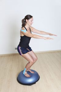 Woman doing physical therapy for weak ankles