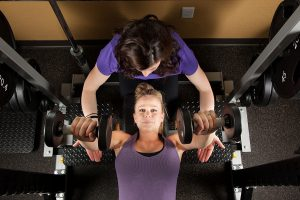 Hire a personal trainer to motivate yourself to work out