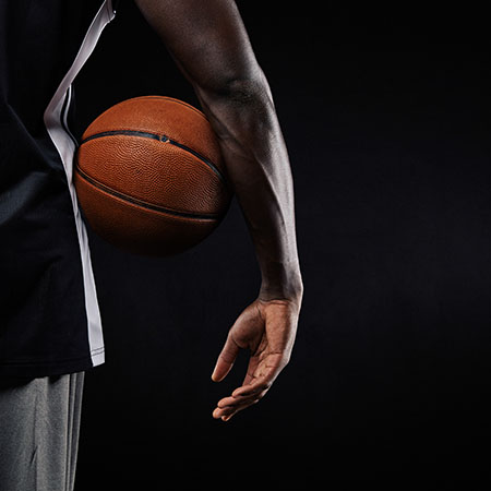 NBA player holding a basketball