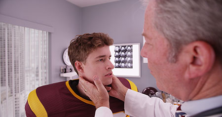 Doctor checking an NFL player for COVID-19